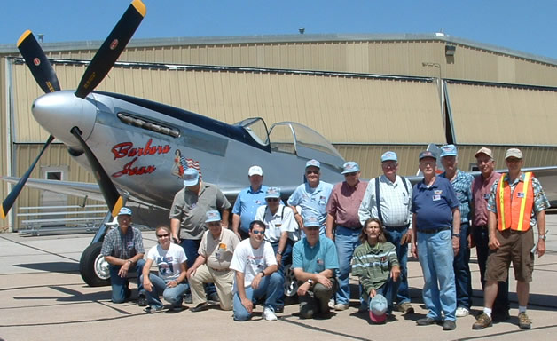 EAA Chapter 1091 in front of a WWII Mustang